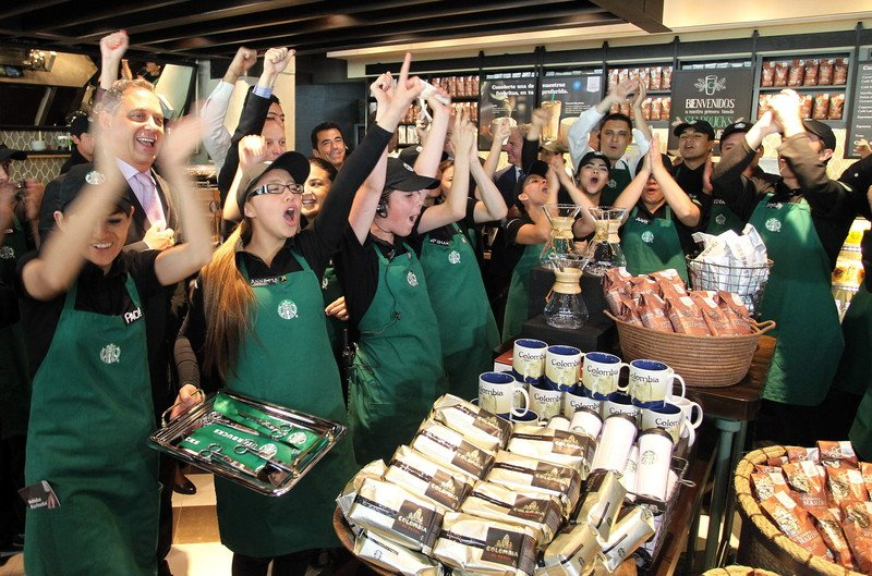 epa04318933 Employees celebrate during opening of the first Starbucks coffe store in Colombia, in Bogota, Colombia, 16 July 2014. EPA/Mauricio Duenas Castaneda